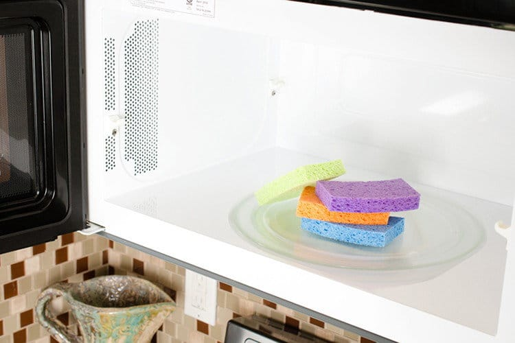 Microwave a damp sponge for 1 minute to disinfect it. #CleaningHack