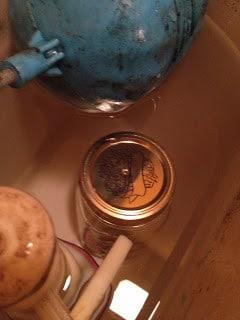 jar of vinegar to toilet water tank to keep toilet clean #cleaninghack
