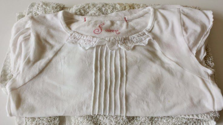 Clean white t-shirt after using easy paint removal tip to remove paint from kids' clothes and school uniform